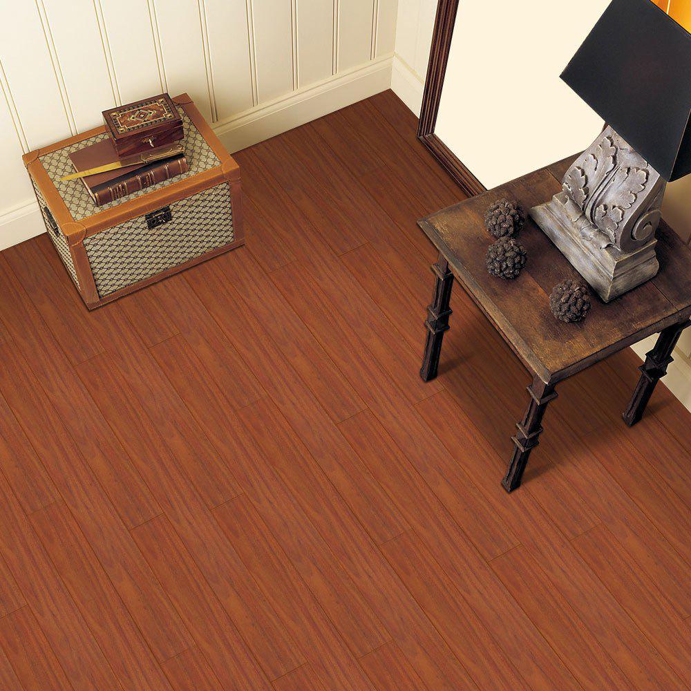 Un autocollant de plancher en vinyle de grain de bois