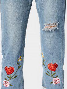 zerrissene jeans mit blumenstickereien und ausgefranstem. Black Bedroom Furniture Sets. Home Design Ideas
