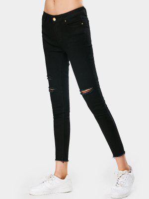Pantalones vaqueros deshilachados delgados del lápiz elástico