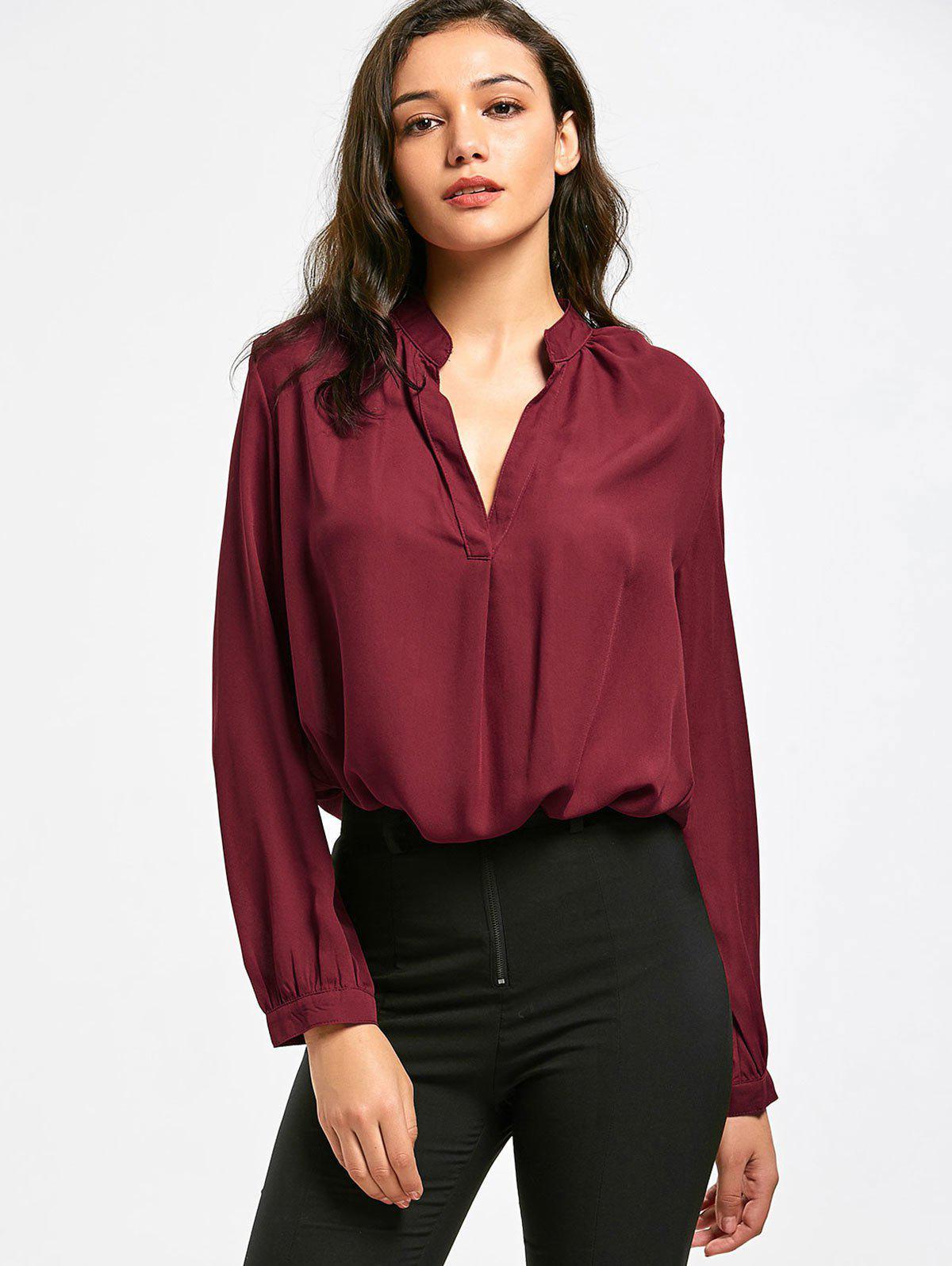 Hohe Niedrige Bluse mit V-Ausschnitt und Langarm