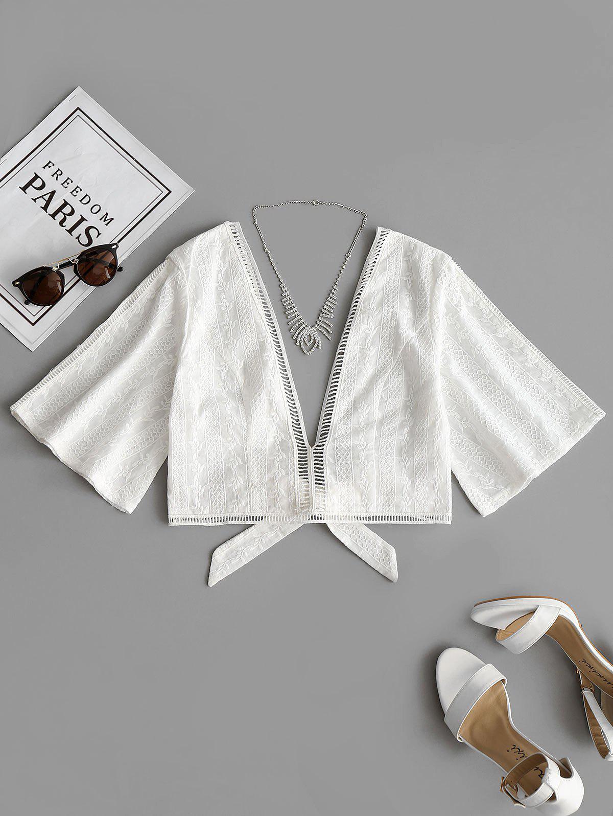 gehkelte bluse mit schleife und saum zenit sis. Black Bedroom Furniture Sets. Home Design Ideas