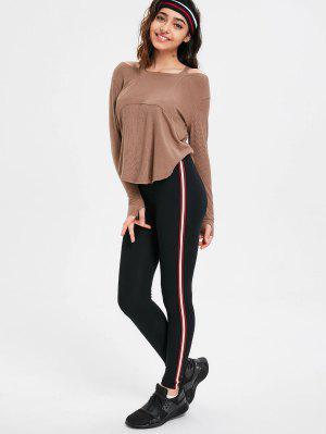 Pantalones pitillo a rayas laterales