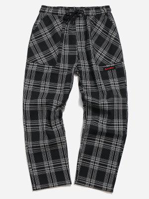 Tela escocesa de cordón nueve minutos de pantalones