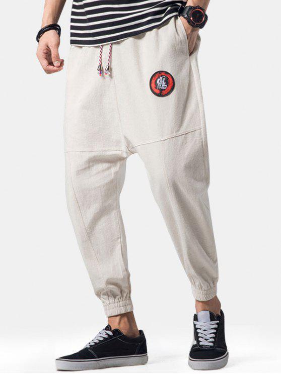 Apliques de bordado Costuras planas Jogger Pants - Caqui Claro M