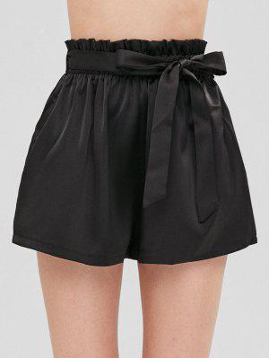 Gefaltete Shorts mit Gürtel und hoher Taille