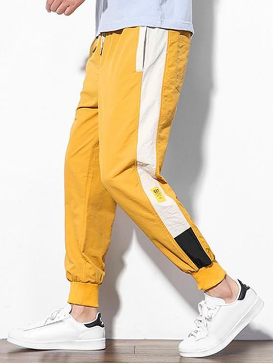 shops Color Block Splicing Applique Casual Jogger Pants - YELLOW L