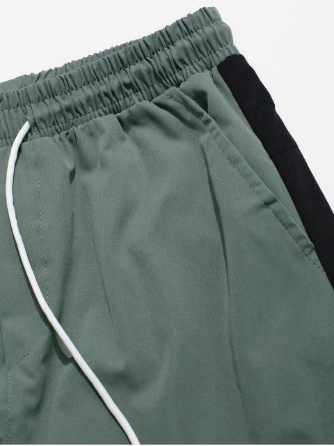unique Color Block Spliced Buckle Ribbon Pocket Letter Print Jogger Pants - BLACK M Mobile