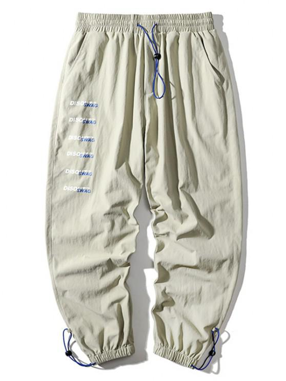 Letter Print Toggle Drawstring Cuff Pants - اللون البيج L